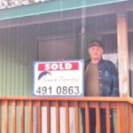 Seward Real Estate Sales Sold Sign with buyer